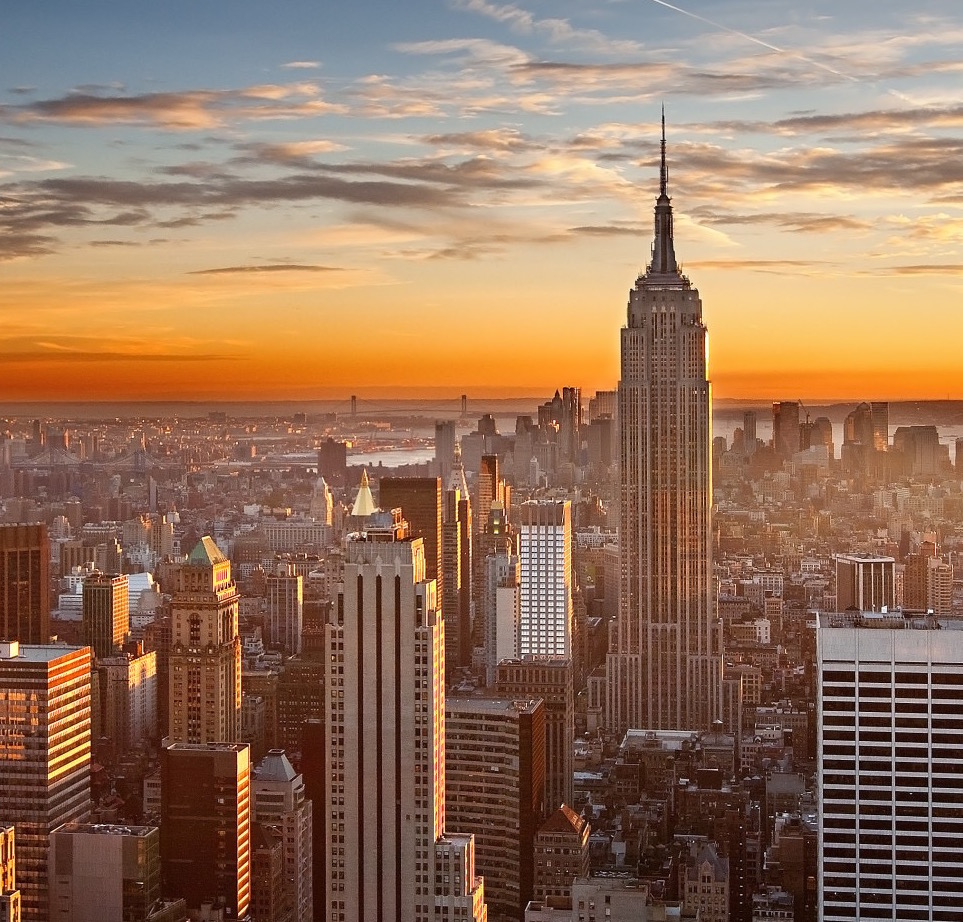 photo of New York City skyline featuring the Empire State Building, the Woolworth, and others