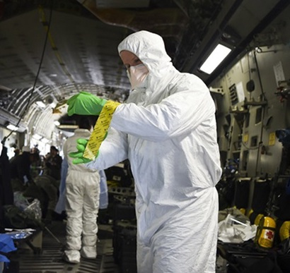 photo of man in hazmat suit